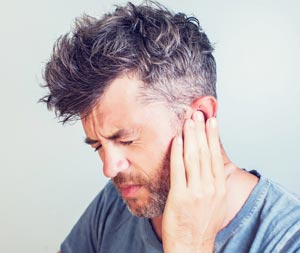 Man suffering from Swimmers Ear